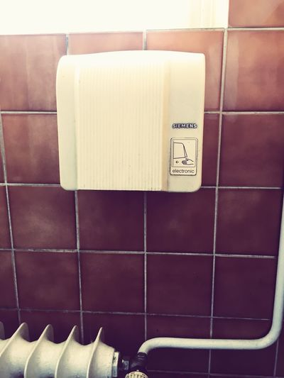 Old hand dryer Indoors  Text Western Script Communication No People Still Life Close-up