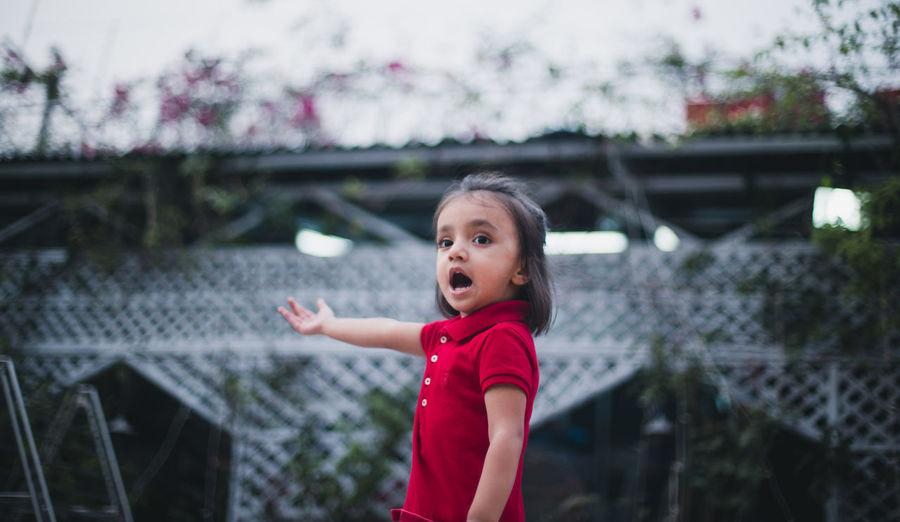 Girl standing outdoors