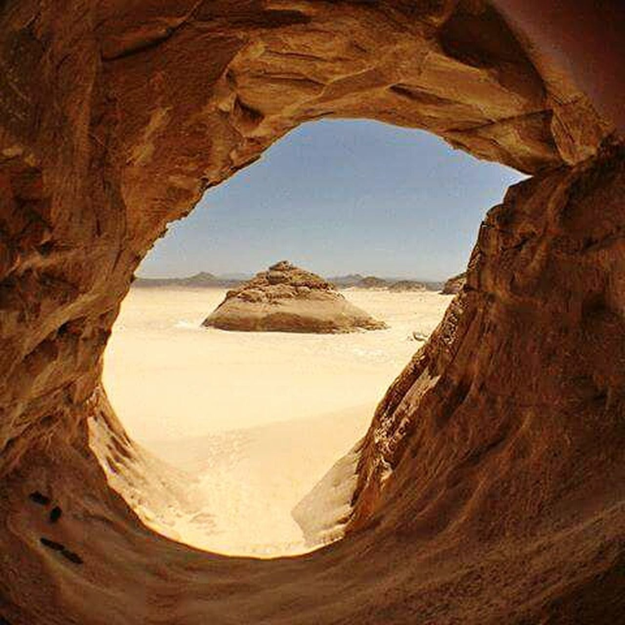 rock formation, geology, rock - object, physical geography, nature, sandstone, desert, natural arch, canyon, beauty in nature, tranquility, extreme terrain, arid climate, travel destinations, landscape, travel, scenics, no people, day, red, sunlight, cliff, clear sky, outdoors, cave, sky