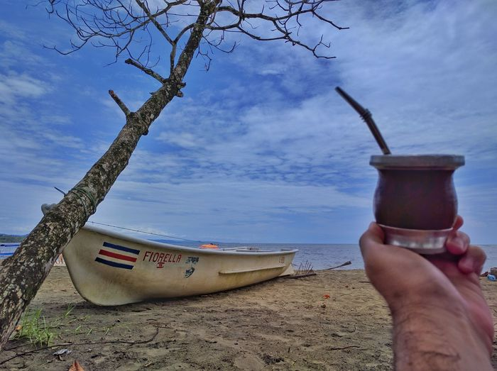 Argentinian Beach Beauty In Nature Close-up Costa Rica Day Human Body Part Human Hand Mate Men Nature Nautical Vessel One Person Outdoors People Real People Sand Sea Sky Tree Water Yerba Mate