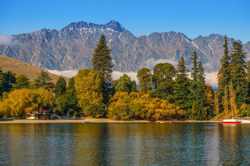 Scenic autumn colors at Lake Wakatipu, NZ Day Lake Landscape Mountain Mountain Peak Nature No People Outdoors Reflection Sky Sunset Tree Water