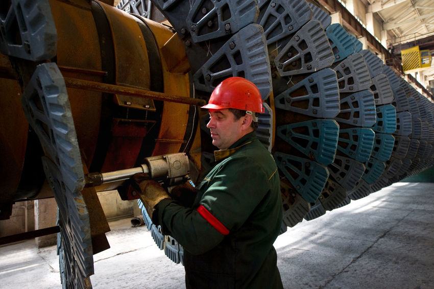 Russia, Stary Oskol, Stoilensky Mining and processing plant, repair of equipment for beneficiation plant Architecture Building Built Structure Casual Clothing City City Life Day Leisure Activity Lifestyles Metallurgy Mining Industry NLMK Outdoors