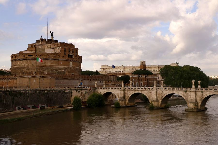 The imposing Castel Sant'Angelo in Rome Italy as viewed across the river Tiber, originally the tomb of Emperor Hadrian 138AD from the beginning of the 14th century it was converted to a castle by successive popes. Ancient History Castle Historical Building Tourist Attraction  Travel Photography Arch Arch Bridge Architecture Bridge Bridge - Man Made Structure Building Building Exterior Built Structure Europe Fortification History No People Outdoors River The Past Tourism Tourist Destination Travel Travel Destination Water