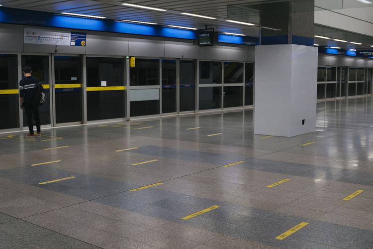Illuminated text on tiled floor at subway station