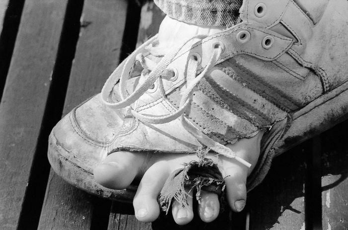 Skunk Contest Volunteer Black & White Child Close-up Day Destroyed Shoe Film Foot Land Vehicle No People Shoe Laces Transportation Wood Slats