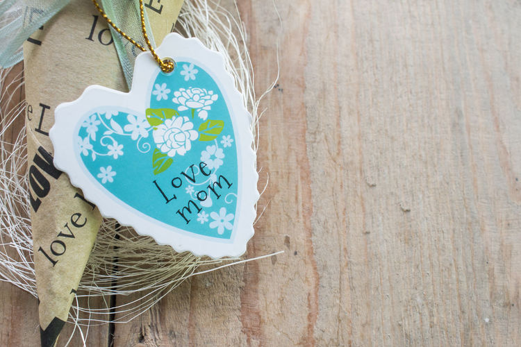 Happy mothers day Blue Close-up Communication Day Emotion Hanging Heart Shape High Angle View Indoors  Information Love Message No People Positive Emotion Sign Still Life Table Text Western Script Wood - Material
