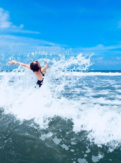 Aquatic Sport Beauty In Nature Day Enjoyment Freedom Horizon Over Water Human Arm Leisure Activity Lifestyles Motion Nature One Person Outdoors Real People Sea Sky Splashing Sport Surfing Water Waterfront Wave