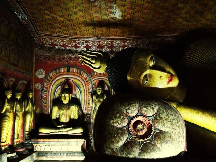Buddha Reclining in the dark Golden Cave Temple in Dambulla Sri Lanka