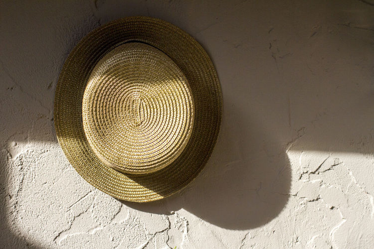 Close-up of hat hanging on wall