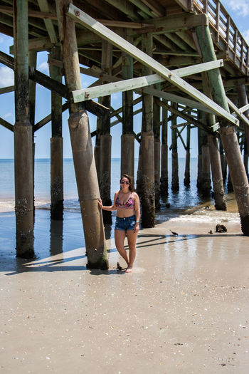 Beach Life Beach Photography Bikini Top Flagler Beach, Florida Flagler Pier Pier Beach Beach Hair Dont Care Brown Hair Cutoffs Day Horizon Horizon Over Water Leisure Activity Lifestyles Ocean Ocean Front One Person Outdoors Real People Sand And Sea Sand And Surf Sunglasses Water Waves