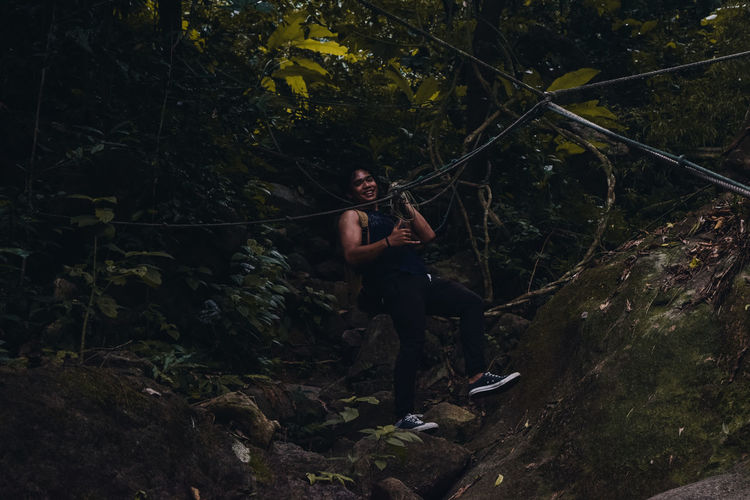 Woman Zip Lining In Forest
