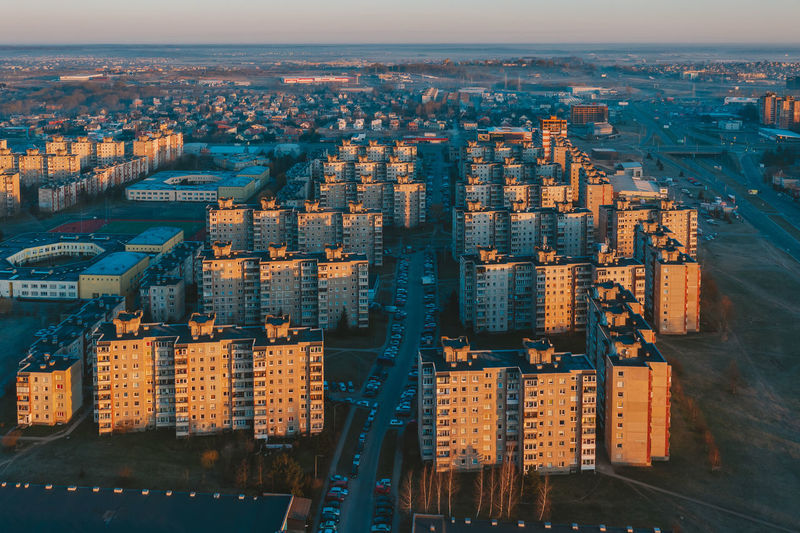 Aerial view of modern buildings at sunset