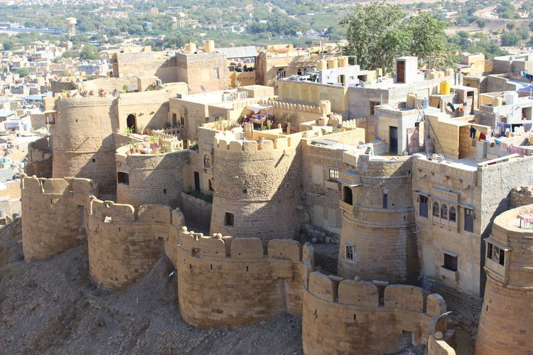 jaisalmer fort in rajasthan High Angle View Highlands Buldingstructure Sand Jaisalmer Fort Rajasthan No People Civilization Archaeology Fortified Wall