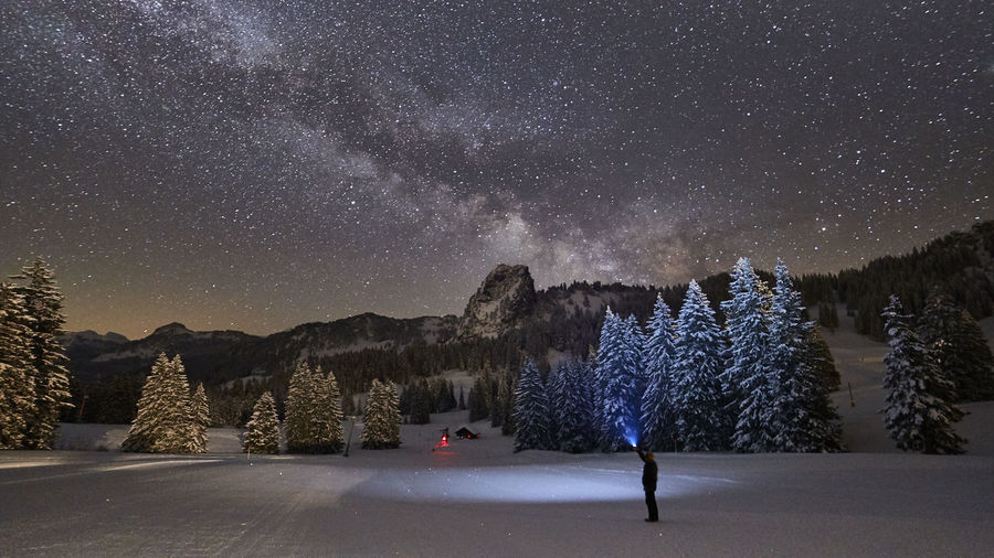 Light Nature Photography Nightphotography Trees Winter Wintertime Astronomy Beauty In Nature Cold Temperature Galaxy Landscape Milky Way Milkyway Mountain Nature Night No People Pine Tree Scenics - Nature Sky Snow Snowcapped Mountain Space Star - Space Tranquil Scene