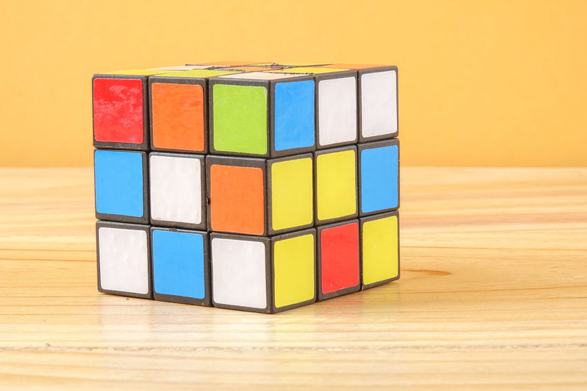 RUBIK'S CUBE , CREATIVITY TOY Creativity Rubik Cube Arrangement Block Block Shape Choice Close-up Cube Shape Geometric Shape Indoors  Intelligence Large Group Of Objects Multi Colored No People Rubik Shape Stack Still Life Table Toy Toy Block Variation Wood - Material