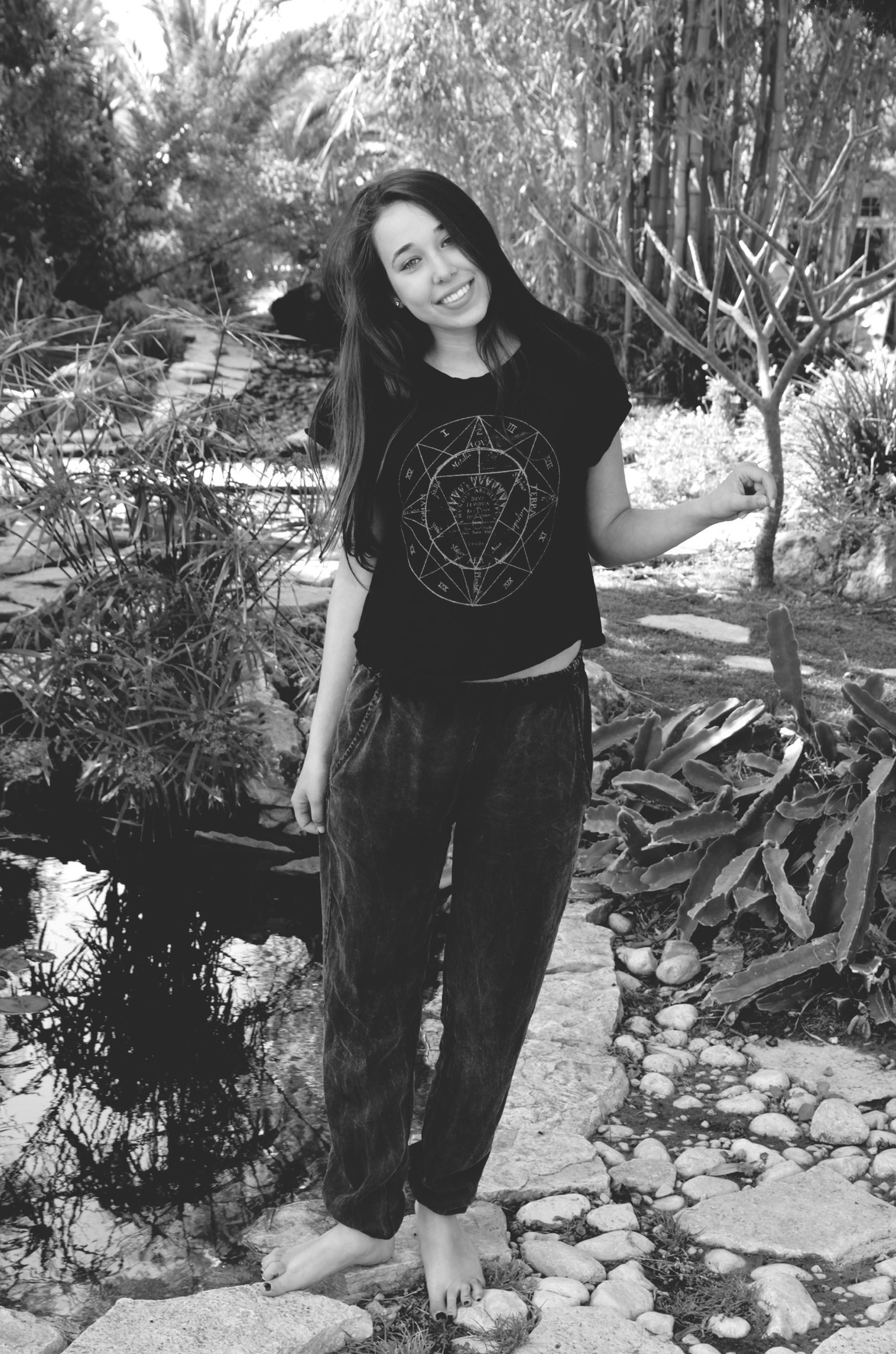 young adult, person, lifestyles, casual clothing, young women, tree, front view, looking at camera, full length, leisure activity, portrait, standing, three quarter length, smiling, day, outdoors, long hair