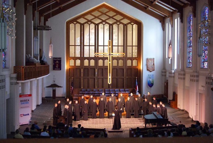 Chorus World Choir Games Musica Sacra Concert Choir  Candle Architecture Built Structure Religion Window Spirituality Belief Place Of Worship Crowd Group Of People Indoors  Illuminated Building Event Women Architectural Column Altar Adult Real People Celebration