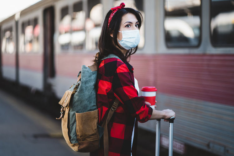 Portrait of woman standing by train