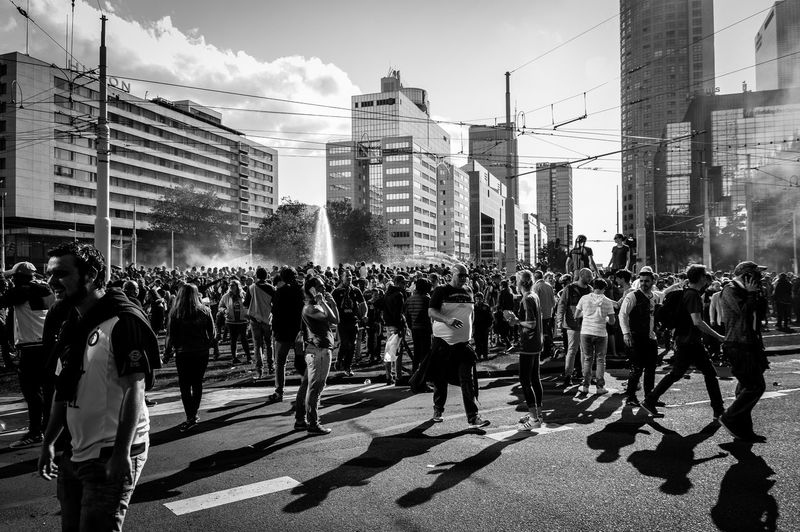 My last photo of the city celebrating. Large Group Of People Building Exterior City Street Crowd Outdoors Skyscraper Day People The Street Photographer - 2017 EyeEm Awards Passion Celebration Excitement Champions Feyenoord Street Photography Streetphoto Streetphotographer Rotterdam Rotterdam, Netherlands Togetherness Streetphotography City Black And White Photography Black & White Streetphoto_bw