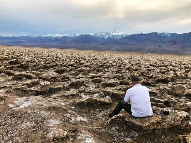 Lost in Thought Beauty In Nature Landscape Mountain Range Rock - Object One Person Cloud - Sky Sitting Outdoors Tranquil Scene Tranquility Death Valley Death Valley National Park Devils Golf Course National Park