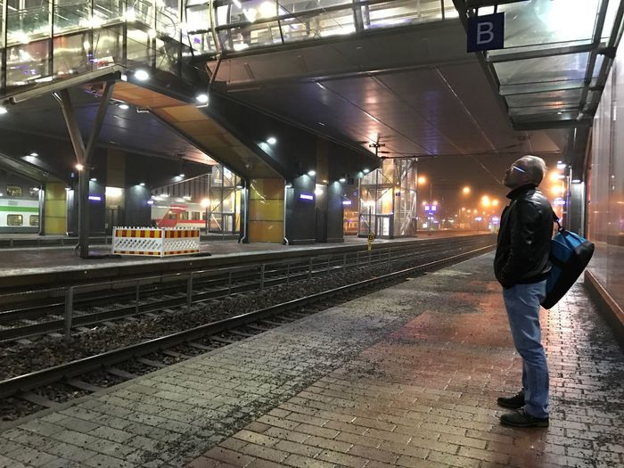 Man waits for a commuter train at a platform of VR Tikkurila station near Helsinki, Finland on a foggy evening Illuminated Full Length One Person Railroad Station Night Transportation Standing Real People Built Structure Rail Transportation Leisure Activity Men Public Transportation Indoors  Architecture People Young Adult Adults Only Adult One Man Only