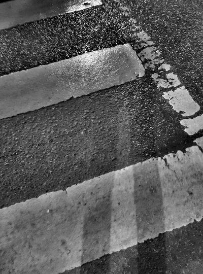 Spirit in the material world Road Wet Street Rainy Full Frame Outdoors Road Marking Zebra Crossing Shadow Ghost Pedestrian Walk This Way Dramatic Angles EyeEm Masterclass Bnw Eyeem Photography Black & White Monochrome Pivotal Ideas Night Photography From My Point Of View Monochrome Photography The City Light Black And White Friday