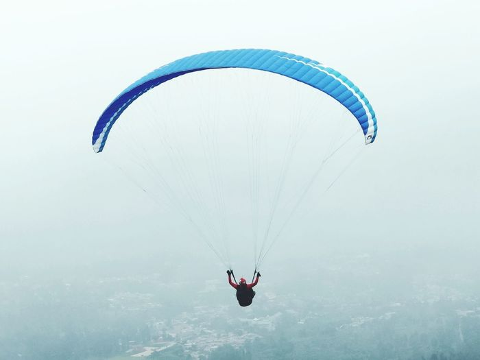 On vacation while enjoying the sensation of paragliding