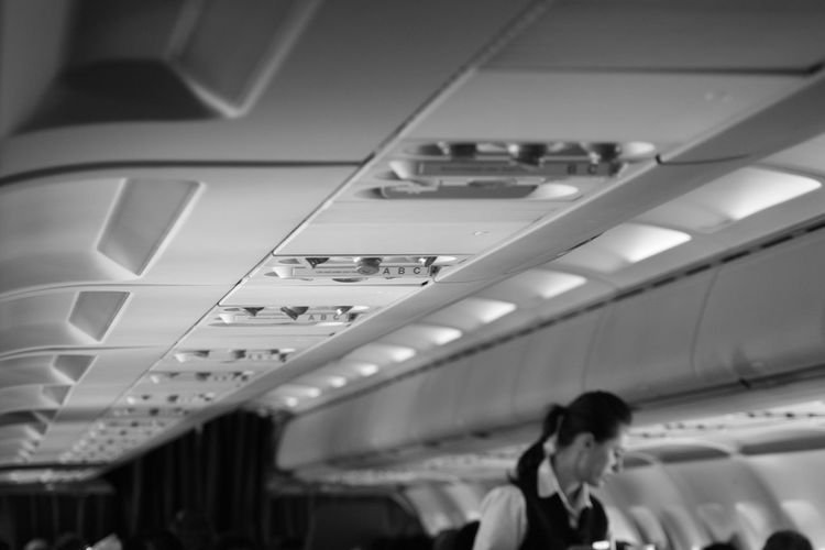 Airplane Blackandwhite Day Indoors  Lifestyles One Person People Public Transportation Real People Stewardess Transportation Travel Women