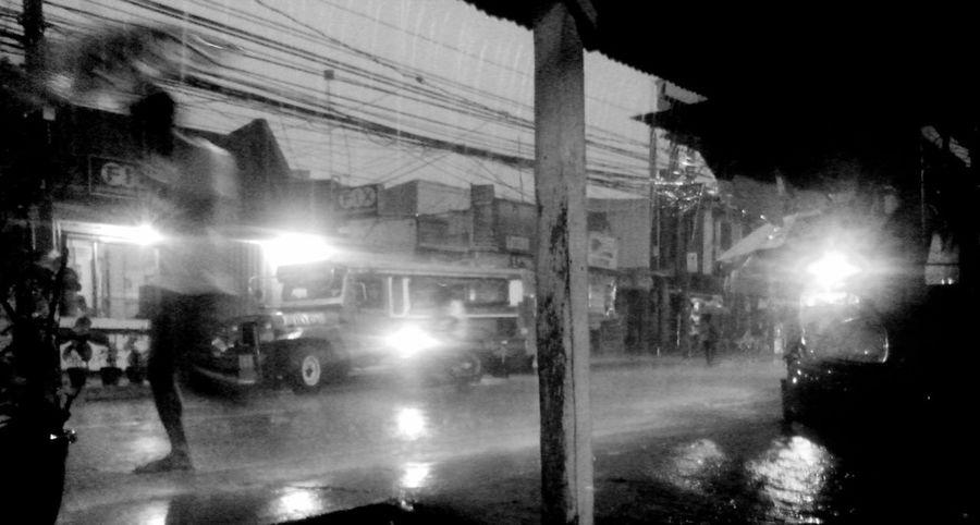 The Street Photographer - 2015 EyeEm Awards Eyeem Philippines Bwphotography Cubao Mobilephotography Streetphotography RainyDays Quezoncity EyeEm Best Shots Urbanphotography