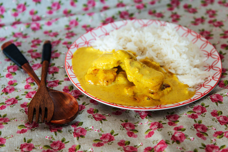 Curry and rice in plate on table
