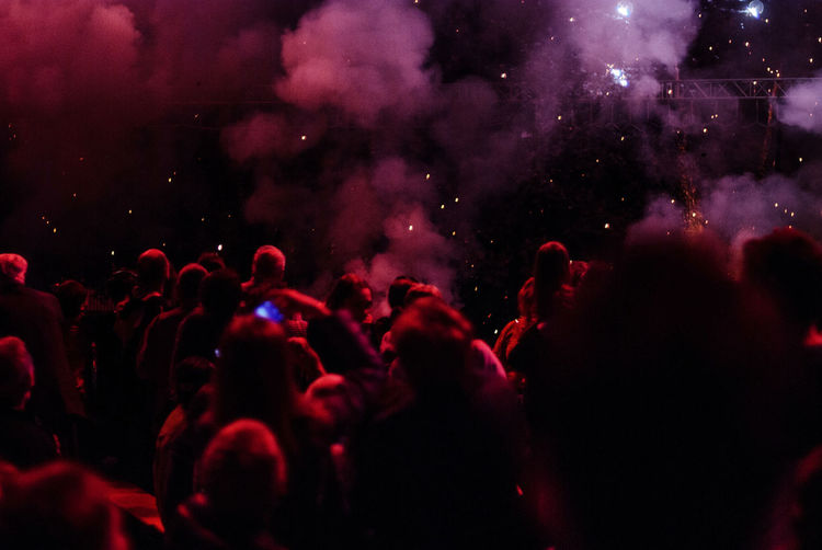 Crowd By Smoke At Music Concert During Night