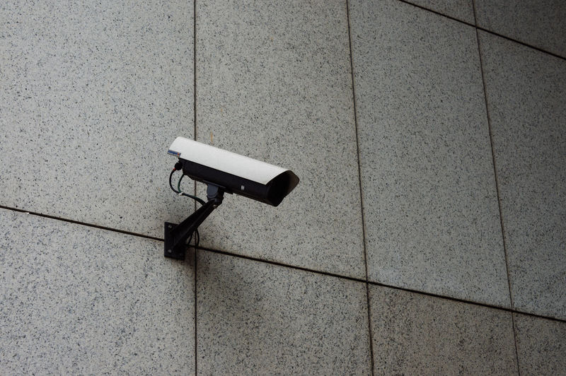 Surveillance camera mounted on a wall