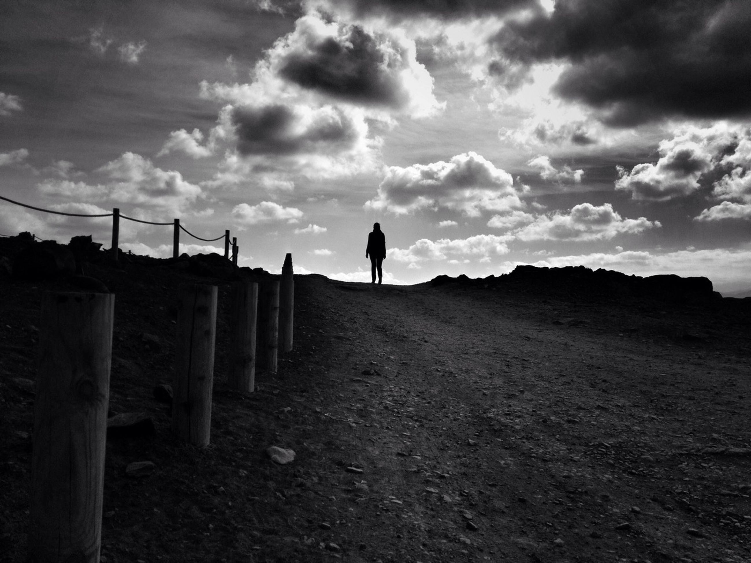 sky, rear view, cloud - sky, full length, lifestyles, men, standing, the way forward, walking, cloudy, leisure activity, cloud, silhouette, person, tranquility, nature, landscape, tranquil scene