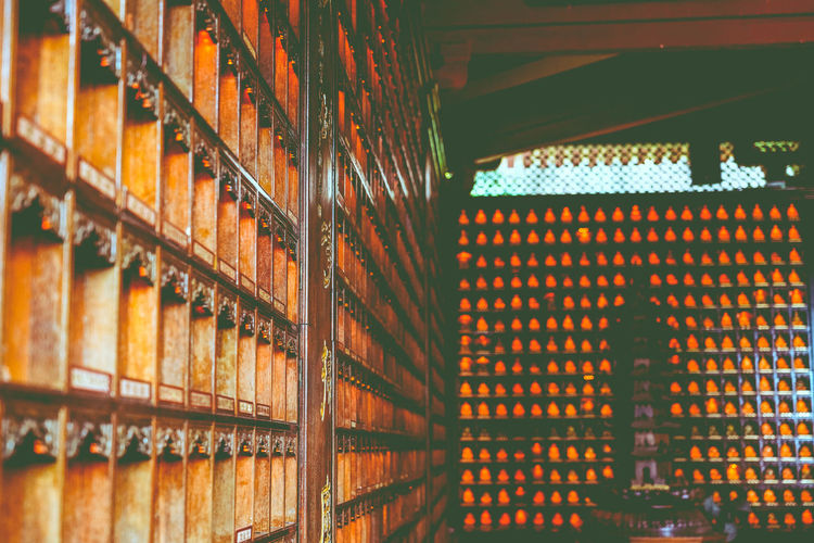 temple in xiamen Indoors  Shelf No People Large Group Of Objects In A Row Order Architecture Bottle Abundance Arrangement Building Cellar Food And Drink Pattern Container Wood - Material Stack Illuminated Refreshment Drink