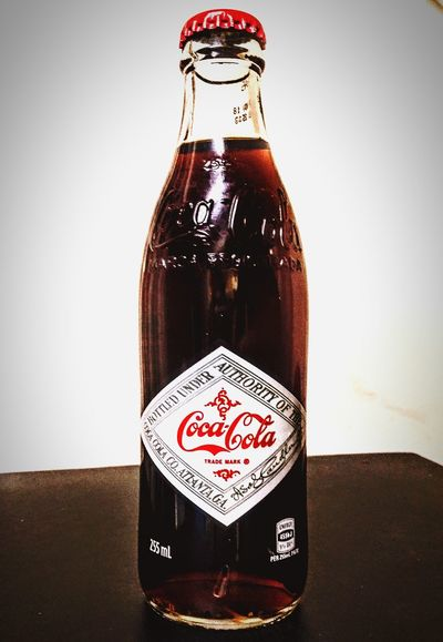 reproduction (replica) bottle of vintage Coke. Atlanta Ga Coke, It's The Real Thing CokeAddsLife It's The Real Thing Coca-Cola, Label/logo/sign Atlanta Coke Adds Life Glass - Material No People! Taking Photos No People Glass Glass Objects  Check This Out Cocacola Cokebottle Coke Bottles Reproduction Coke Design Coke Bottle CokeBottles WesternScript Coca~Cola Labeling Coke Collection Coca-cola Coca~cola Vintage Coke Coca~Cola ® Text