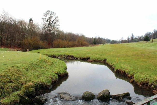 Stream running through a golf course just outside Edinburgh, Scotland Golfcourse Water Tranquil Scene Tranquility Stream Green Beauty In Nature Grass Nature Landscape Idyllic Day Outdoors Edinburgh Scotland Sky Remote Standing Water Hill
