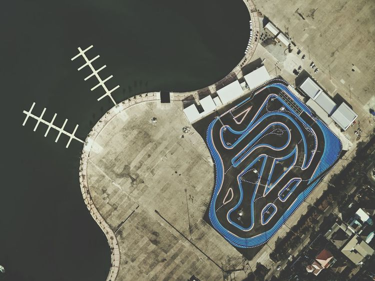 View from above of go kart racing track by the lake taken by drone Curves Adrenaline Driver Fast Speed Go Karting Go Kart Race Track Race View From Above Above Drone  High Angle View Lake Water Sports The Week On Eyem Fresh On Eyeem  Geometric Shape Below Looking Down Looking Below Looking Down From Above Looking From Above Pattern Flying High