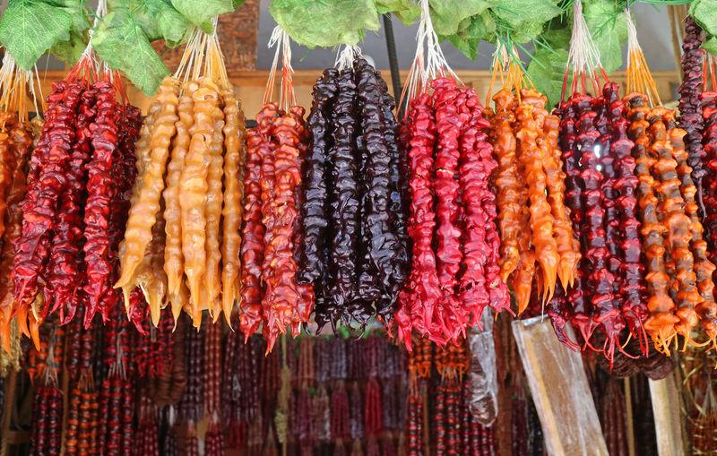 Close-up of various fruits hanging at market stall