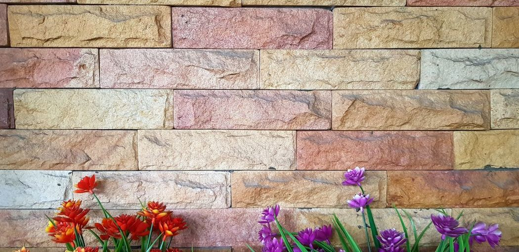 Full frame shot of multi colored stone wall
