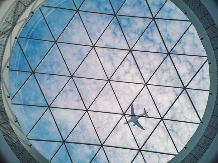 While walking the aisle of a commercial center, I found myself right under a round window built. I looked right up and saw blue and cloud cross by a plane. An original composition to which is added this strange triangle pattern geometry. Interior Design Urban Directly Below Geometry Window Plane Blue Sky Cloud - Sky Clouds And Sky Clouds Sky Flying Round Pyramid Shape Looking Up Lookingup Architecture_collection Backgrounds Pattern Sky Architecture Built Structure Architectural Design Triangle Architecture And Art Architectural Feature Architectural Detail Geometric Shape Triangle Shape Ceiling My Best Photo