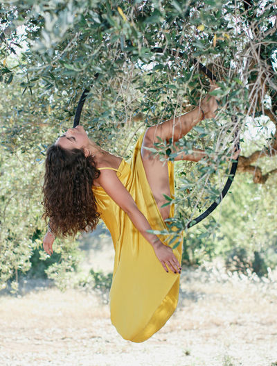 Woman standing by tree