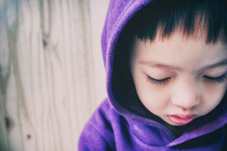 Close-up of boy in hooded shirt