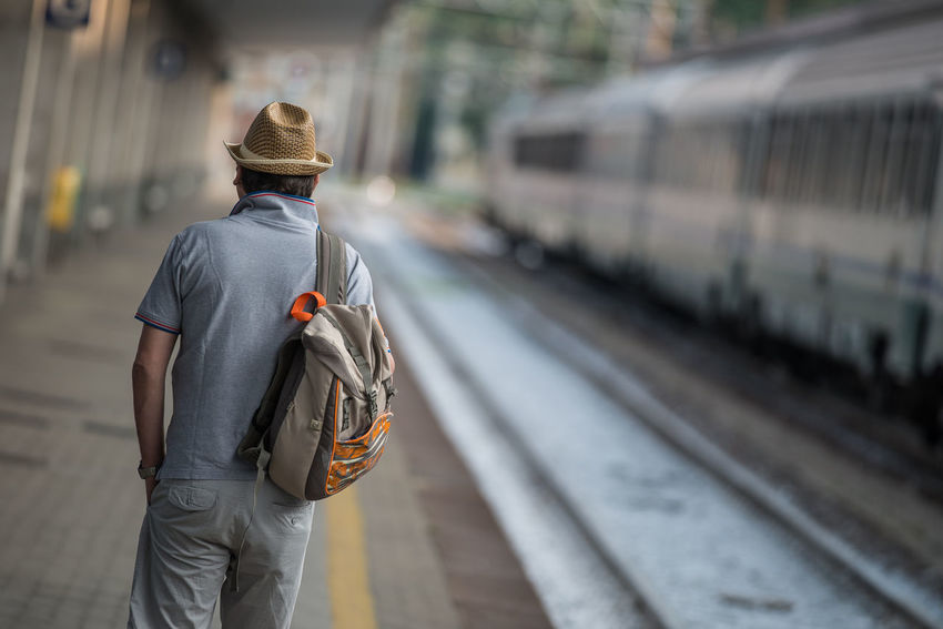Man with hat in a train station platform Casual Clothing Focus On Foreground Leisure Activity Lifestyles Man Man With Hat Outdoors Railway Selective Focus Train Train Station Travel Traveller Unrecognizable Person