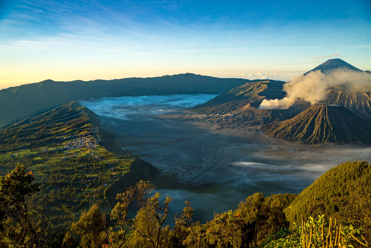 The famous view of Mount bromo from view point. It very popular spot for take a photo of Mount bromo in sun rise. Beauty In Nature Bromo Day INDONESIA Java Landscape Morning Mount Bromo Mountain Nature No People Outdoors Sky Sun Rise Tourist Tourist Attraction  Tourist Destination Tree Volcano