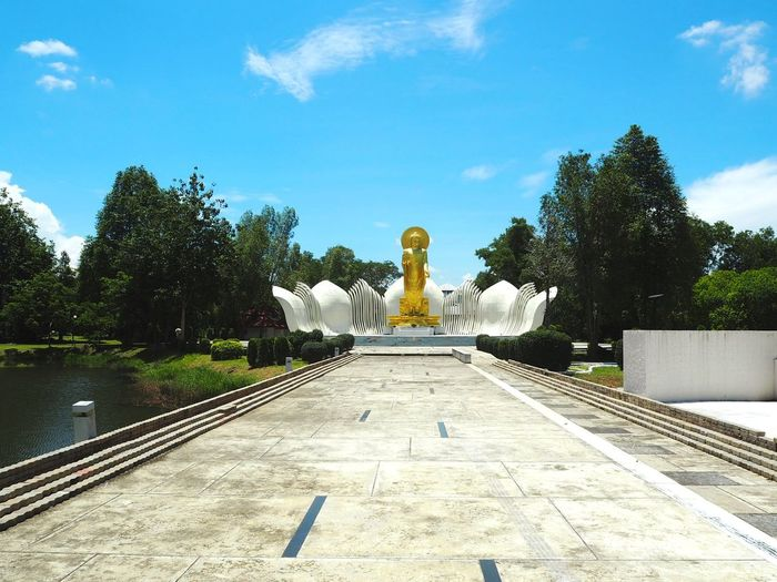 Golden buddha Thailand HelloEyeEm Budda Statue Golden Buddha Statue Sky Tree Plant Direction The Way Forward Day Sculpture Art And Craft No People Cloud - Sky Representation Statue Water Outdoors Travel Destinations Human Representation Architecture