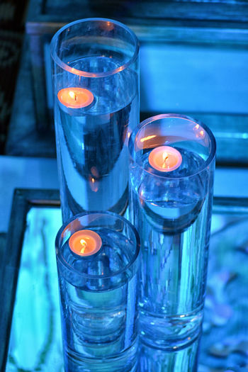 Water Fire Burning Fire - Natural Phenomenon Illuminated Flame Indoors  Candle Glass Glass - Material Close-up Focus On Foreground No People Heat - Temperature Transparent Glowing Blue Tea Light Table Drinking Glass