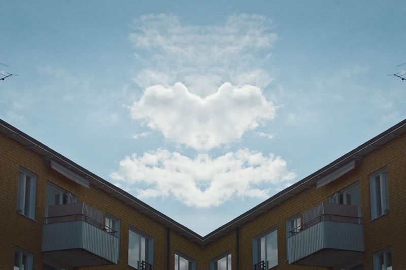 Cloud - Sky Sky Built Structure Building Exterior Architecture Low Angle View Day No People Outdoors Building Window House High Section Heart Shape Positive Emotion Love Blue City My Best Photo The Architect - 2019 EyeEm Awards