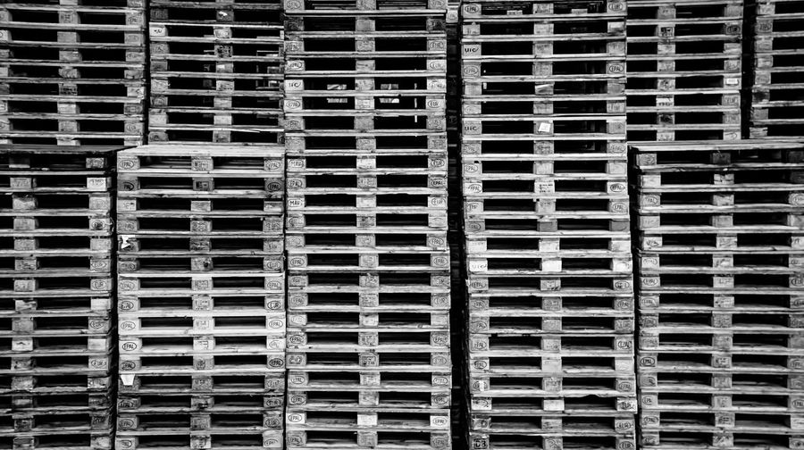 over and over ... Business Close-up Design Detail Geometry Gestapelte Horizontal Symmetry In A Row No People Pattern Pattern Pieces Repetition Symmetry Textured  Transport Transportation Urban Urban Geometry Urbanphotography Wall Wood Wood Wooden Palette Paletten Business Stories