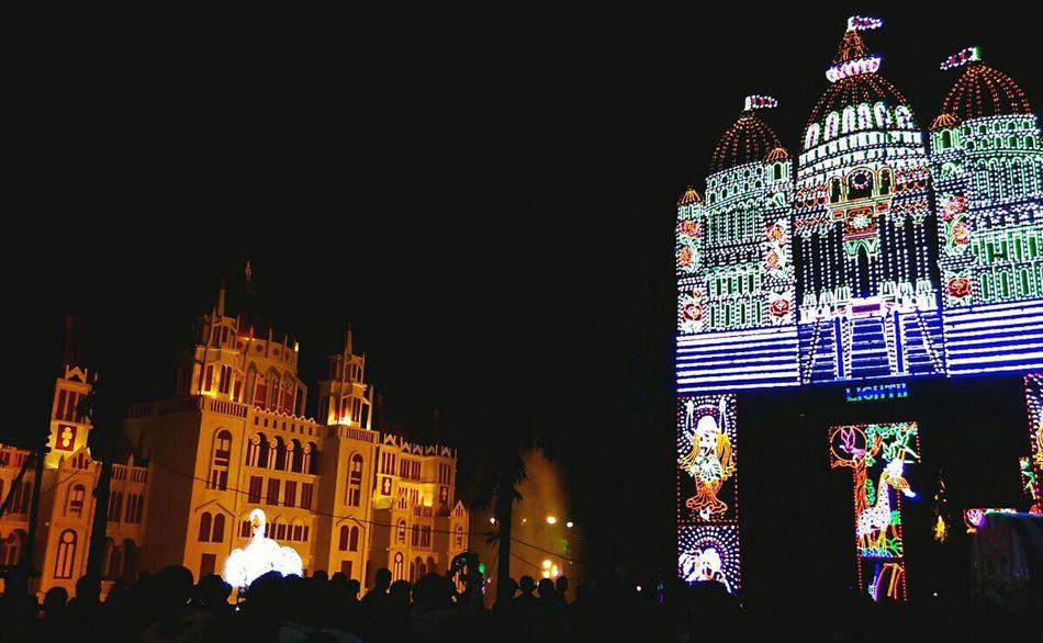 Festival gathering Night Illuminated Arts Culture And Entertainment People Durgapuja Festival India