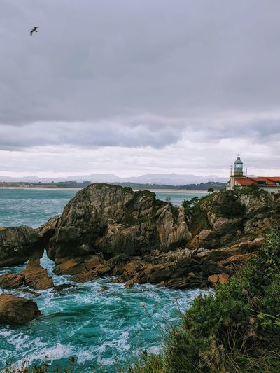 Sea Water Beach Lighthouse Sky Architecture Landscape Horizon Over Water Cloud - Sky Building Exterior Rocky Coastline Seascape Coastline Coast Ocean Wave Shore